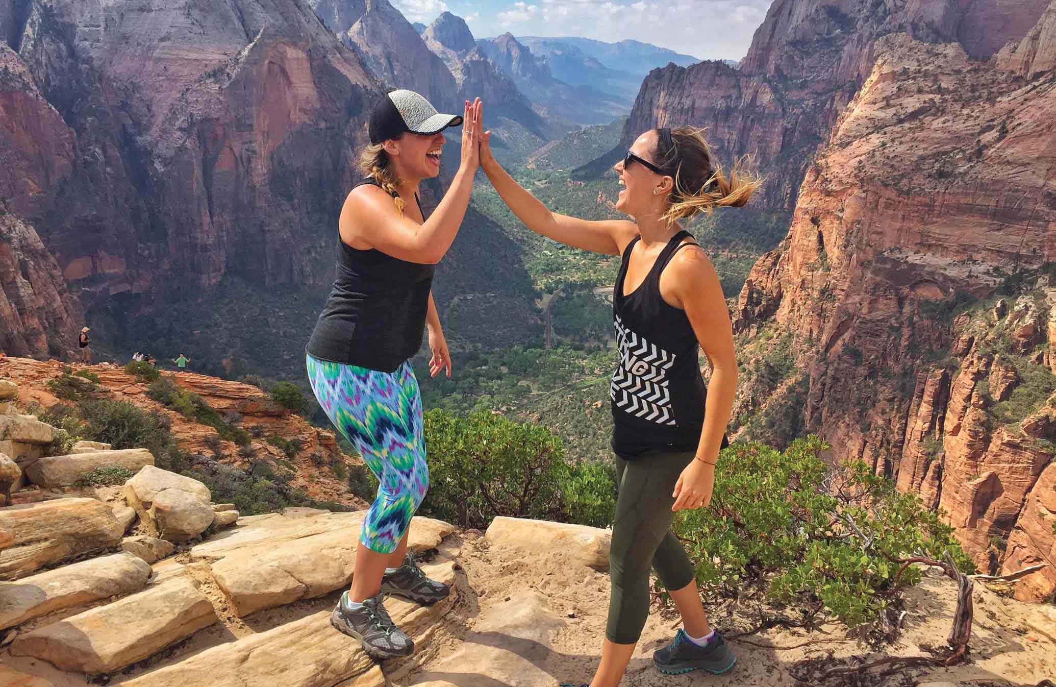 Woman Giving High Five on Hike